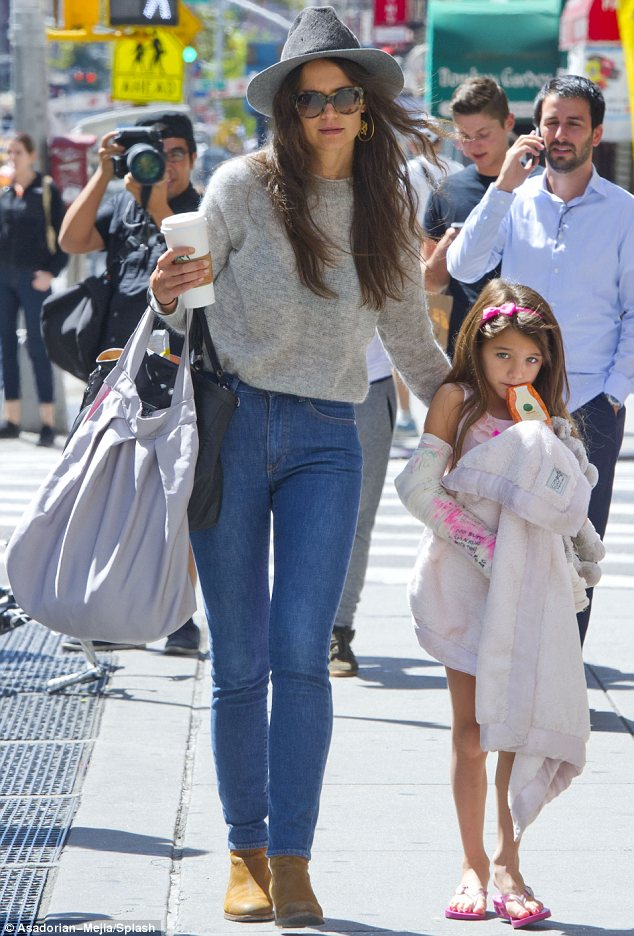 Her favourite accessories: Fashion-loving Suri carried her favourite giraffe cuddly toy and soft blanket
