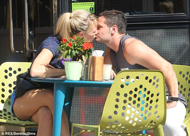 Passionate PDA: Chloe Madeley and her boyfriend Danny Young proved it's not just fitness they're fanatical about as they enjoyed a romantic smooch in the sunshine