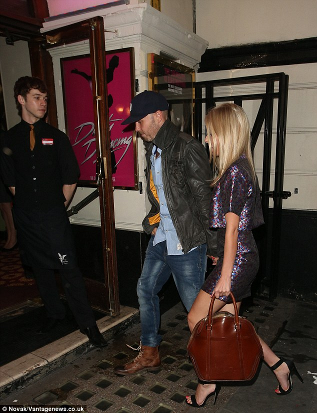 Perfect gentleman: Jordan took Mollie by the hand as he led her into the theatre