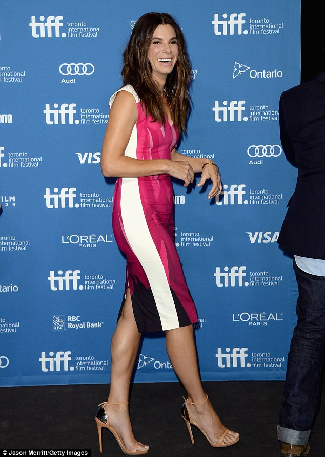 Pretty in pink: Sandra Bullock revealed that she 'didn't feel worthy' of her Oscar while attending a Gravity press conference in Toronto Monday