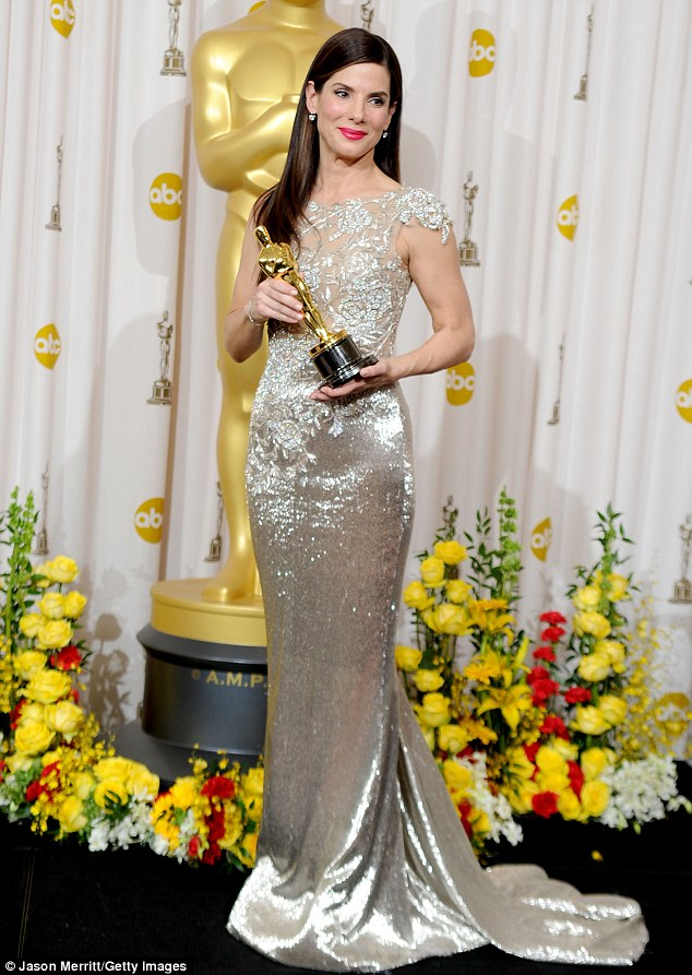 Not worthy? The Golden Globe winner - seen here with her Oscar in 2010 - said she didn't feel worthy and will 'spend the rest of my life hopefully earning it'