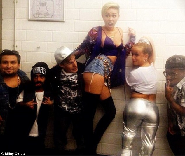 Twerking with dwarves: Miley spanked one of these dancers during a performance in Germany