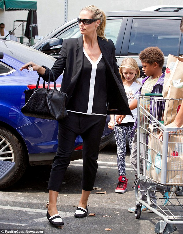 Busy mom: Heidi has been juggling time between her four kids and New York Fashion Week