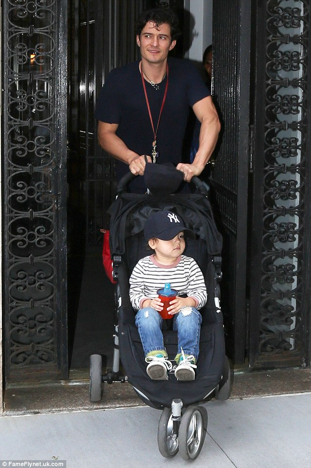 Giving mommy a break: Meanwhile, Miranda's husband Orlando Bloom was seen taking their son Flynn out for a stroll on Monday