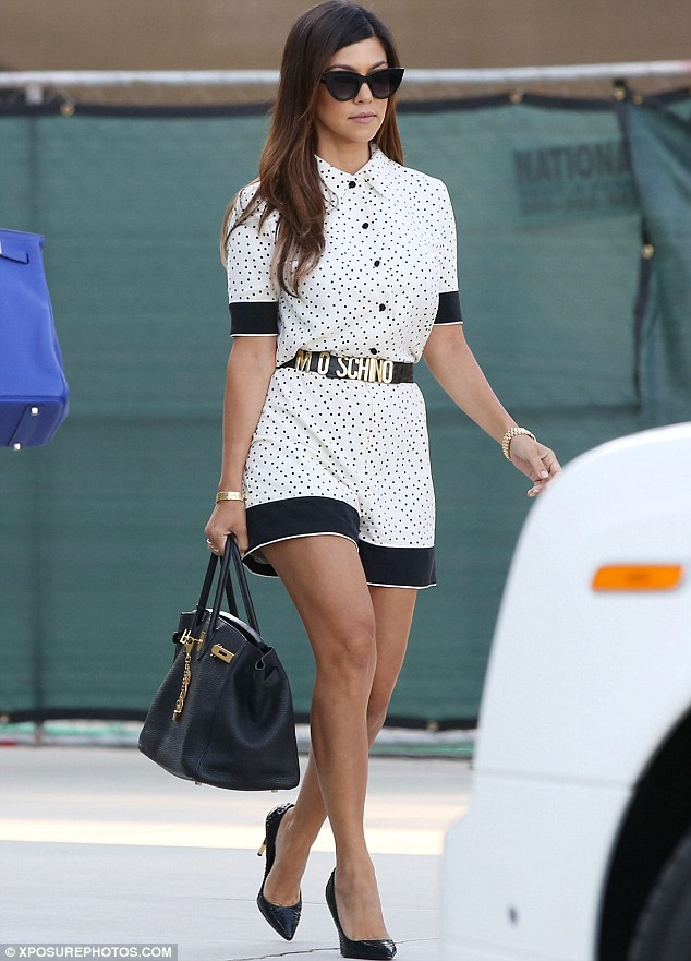 Looking good: Meanwhile Kourtney looked pretty in a polka-dot Moschino outfit
