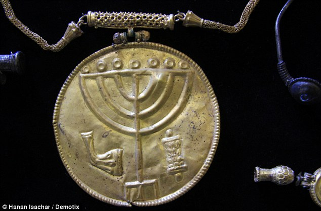 A 10cm medallion etched with a Menorah, Shofar made from a ram's horn and a Torah scroll, (pictured) was found at the same site as the earthenware jug inscribed with the wine label. However, the medallion dates from the 7th Century, unlike the older wine container