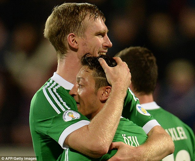 Arsenal axis: Per Mertesacker and Mesut Ozil convincingly combined for Germany as Arsenal fans hope they might at club level