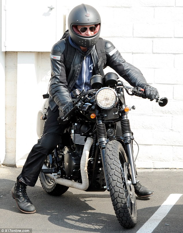 Ready to ride: The actor and avid motorcycle collector made sure to don a helmet before he set off