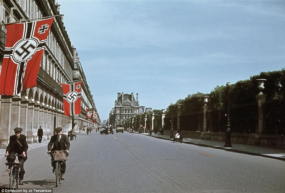 Nazi occupied Paris: Giant Swastikas line the streets of the French capital. Paris fell to the Germans just weeks after the Nazis launched an invasion in 1940