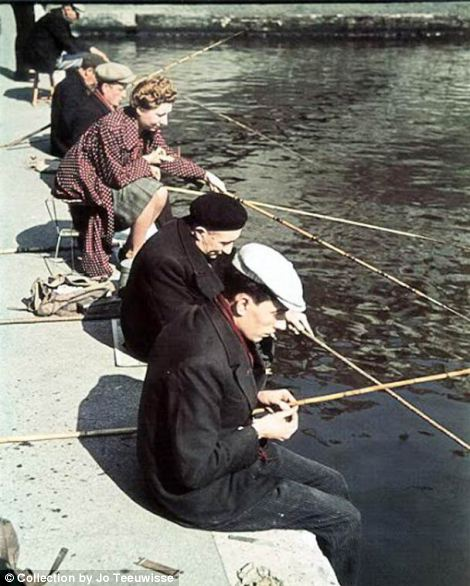 At their leisure: Parisians are shown fishing