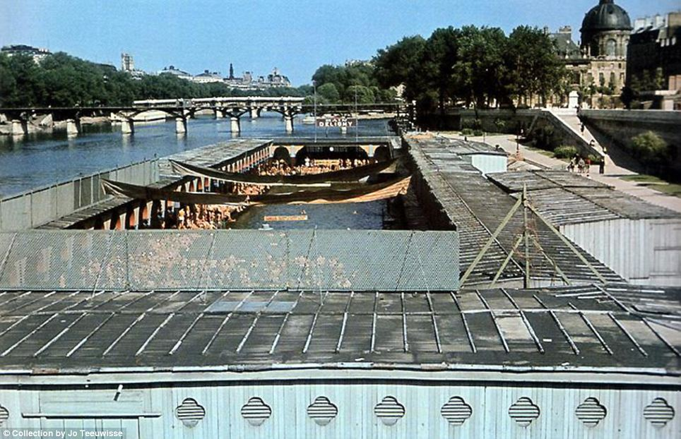 Summer fun: A part of the Seine is pontooned off into a swimming pool, which is filled with hundreds of Parisians grabbing a chance to cool off in the summer heat