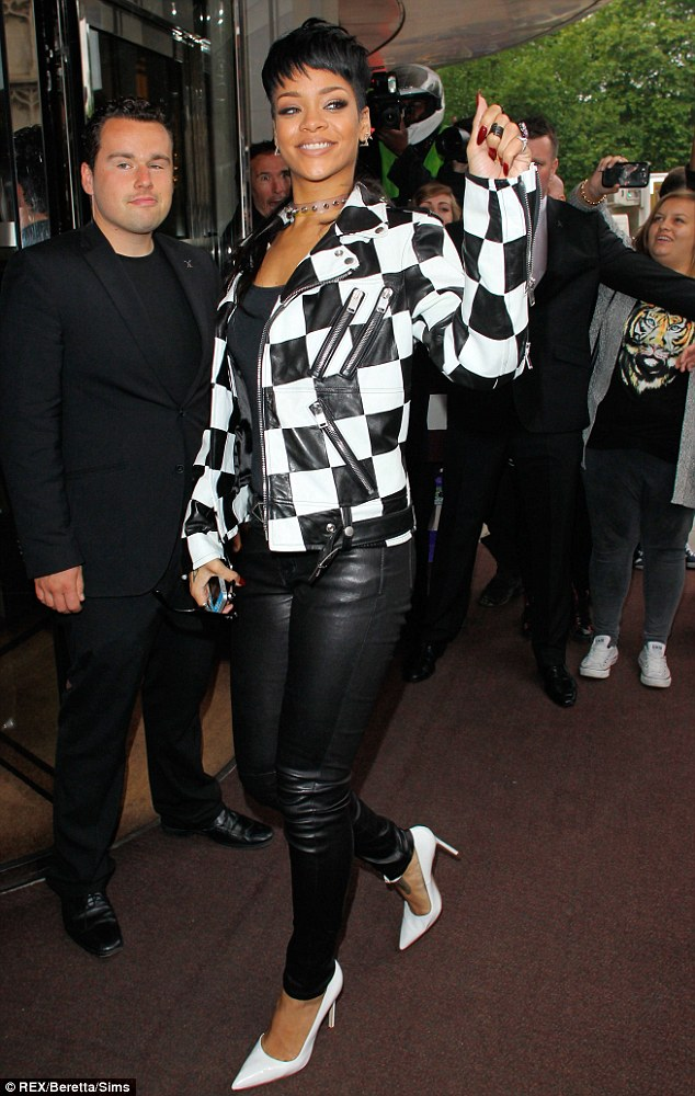 Rihanna looked happy to be surrounded by her adoring fans