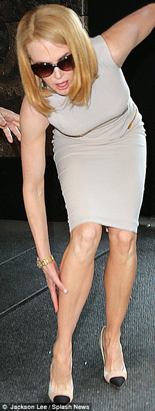Massaging it better: The Australian star rubbed her right leg which bore the brunt of her weight when she fell