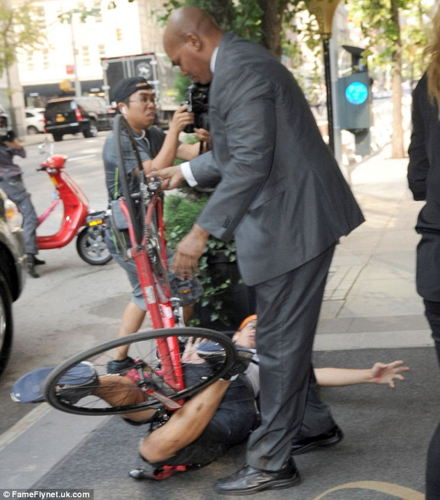 Tangled up: A man tried to separate the photographer from his bike