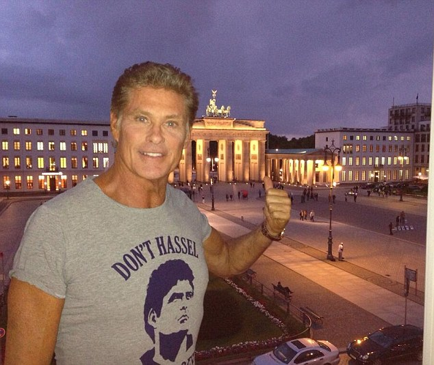 Iconic: David poses Berlin which has changed immeasurably since the Cold War days