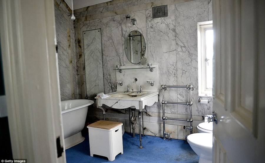 Bathroom of the past: A stand alone bath with an ornate sink dating back three decades