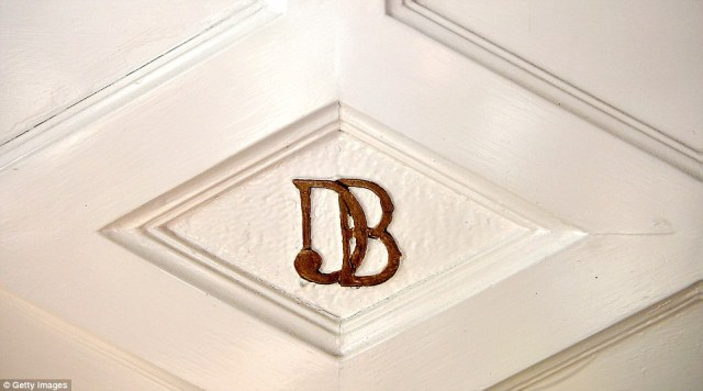 Leaving his mark: Wealthy Sir Dhunjibhoy Bomanji's monogrammed initials are on the front door of Pineheath house