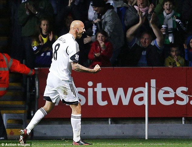 Get in! Shelvey rushed to the Swansea supporters after his header was converted by Michu