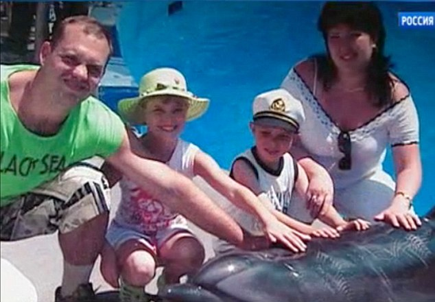 Victims: Former paratrooper Dmitry Chudakov Dmitry and his seven yea-old son were shot in the head. His wife and daughter were stabbed