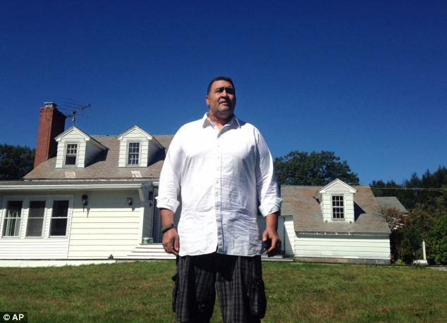 Targeted: Holloway stands in front of the rural vacation home in Stephentown, New York