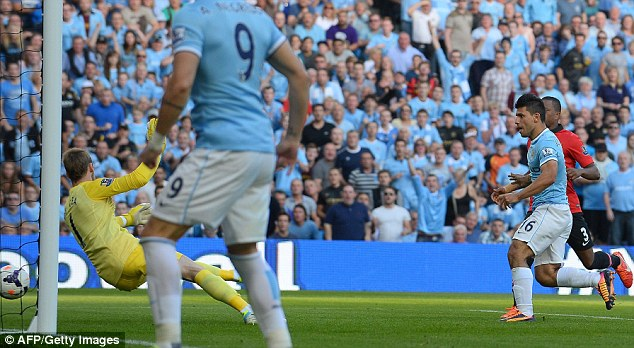 Three and easy: Aguero scores his second and City's third in the derby