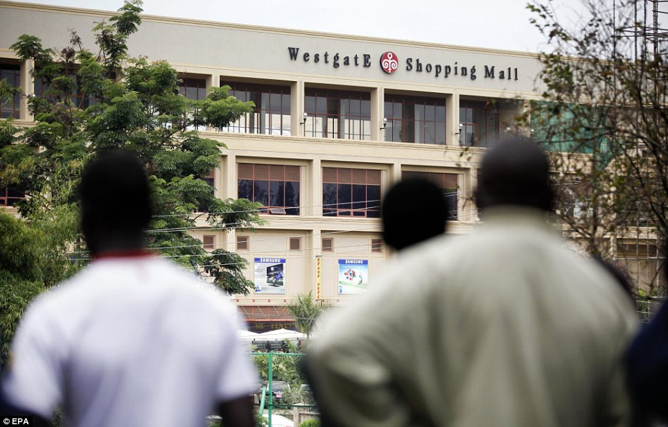 Siege: People look at the Westgate shopping mall in the distance where hostages are being held for the second day