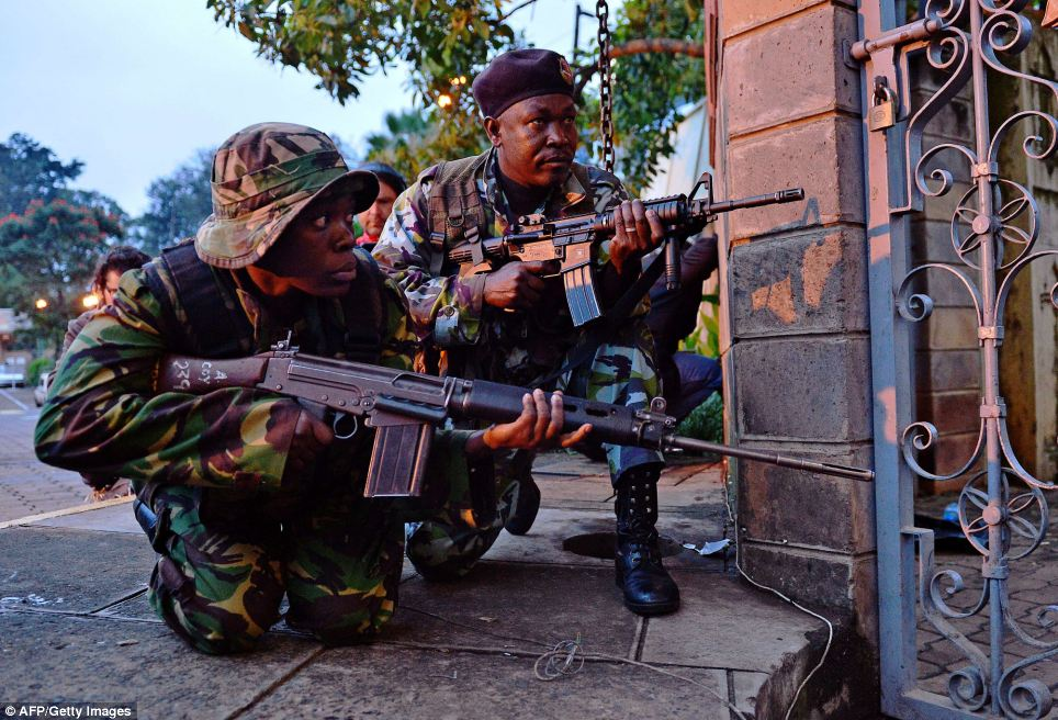 Militants inside Westgate Shopping Centre have threatened to kill the remaining hostages as Kenyan security personnel try to end the siege (pictured)