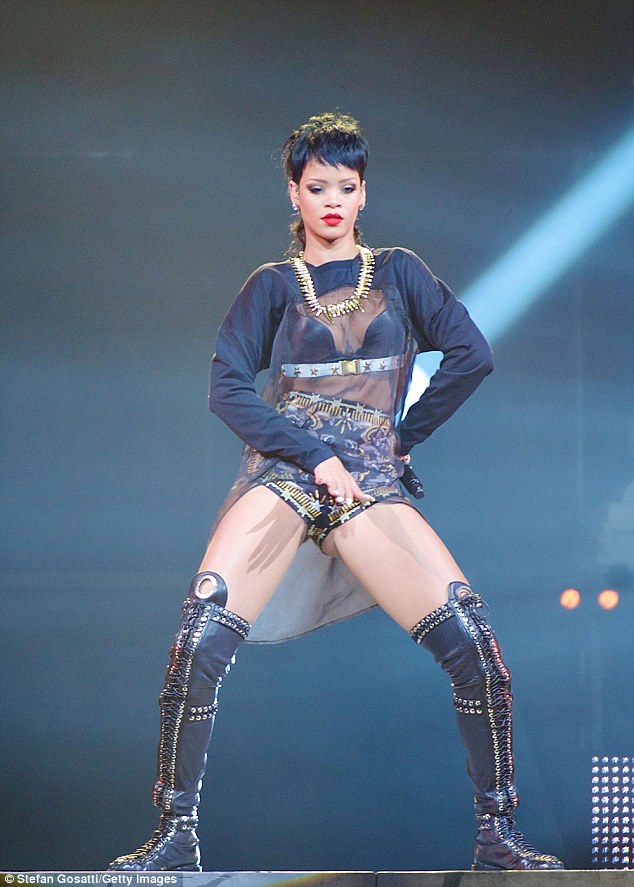 Still on top: Rihanna brushes off lip-synching criticism with a risque concert performance in Perth, Australia on Tuesday