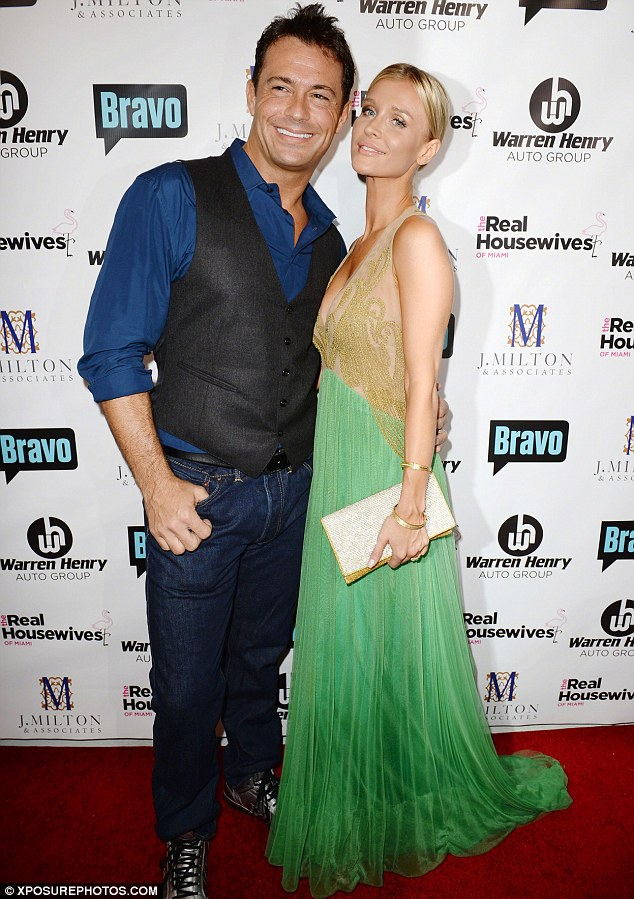 Starved for attention: The Real Housewives Of Miami star, pictured with Romain at the Bravo show's season three premiere on August 3, says that their love life has improved with the help of sex therapy