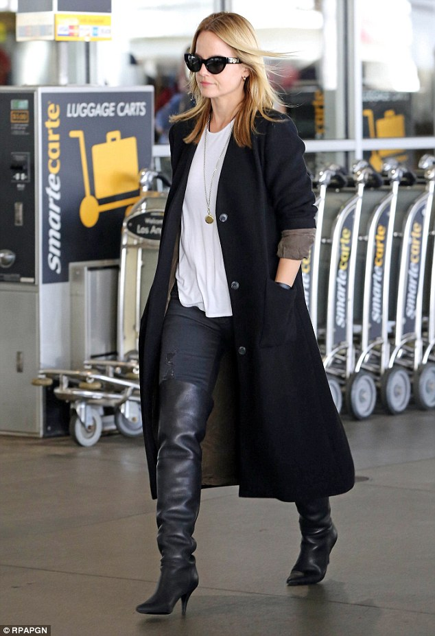 Mena Suvari wears over the knee boots for her plane