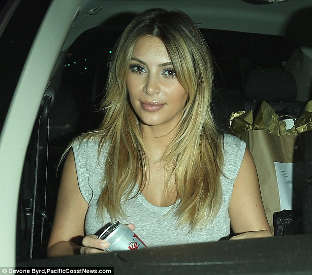 Dedicated: Kim clutches a Diet Coke as she leaves the Vietnamese takeaway restaurant 90210Pho in Beverly Hills amid reports she has 'cut out carbs' from her diet