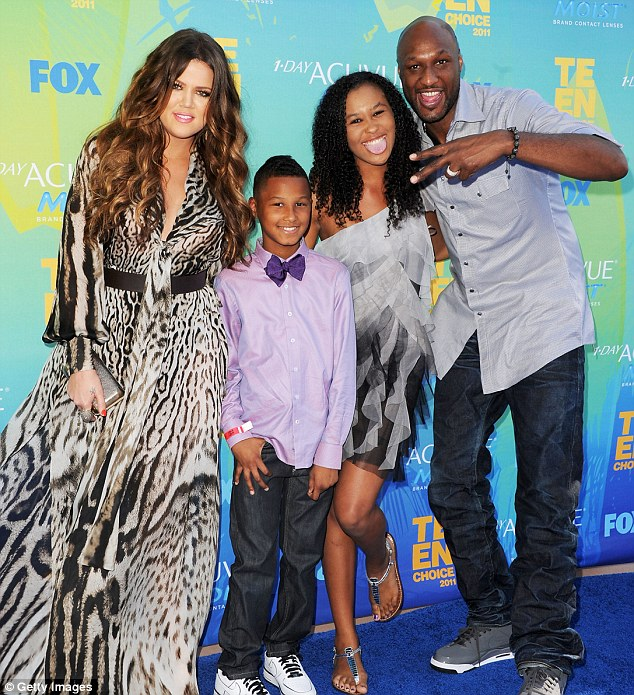 Happy family: Troubled couple Khloe Kardashian and Lamar Odom were joined by his children Destiny and Lamar Odom at the Teen Choice Awards in August 2011 in Los Angeles