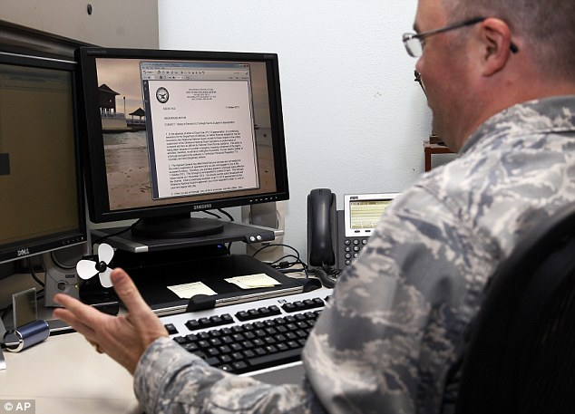 Oklahoma National Guard human resource specialist Major James R Baxter II calls up the notice he was tasked to send to federal employees slated for furlough