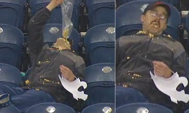 Washington State popcorn guy pours whole bag in mouth