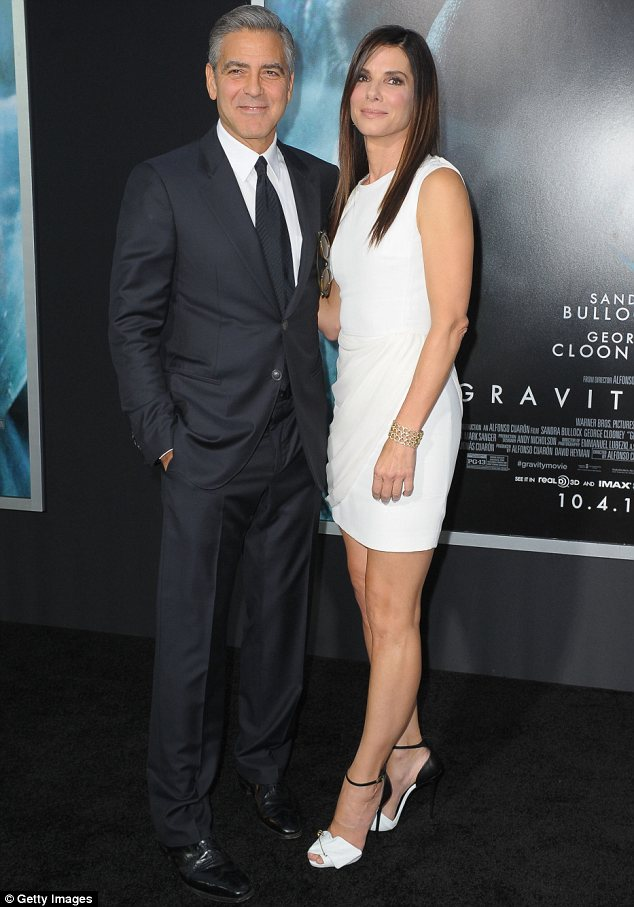 Going it alone: Neither George nor co-star Sandra Bullock took dates to the New York premiere of Gravity on Tuesday