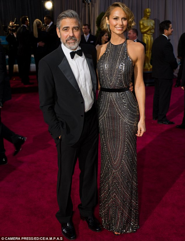 Former flame: George and Stacy Keibler, who he is pictured with at The Oscars in February, broke up in July