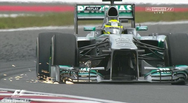 Sparks fly: Nico Rosberg's front wing producing sparks after he overtook Lewis Hamilton