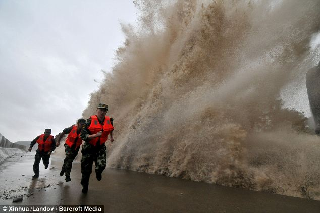 Making waves: Typhoon Fitow struck Fuding city of Fujian province with winds of up to 120 miles an hour causeing huge and powerful waves to pummel the coastline