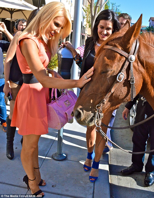 Nice horsie: Gretchen stroked a horse that came out for the party carrying a cowboy