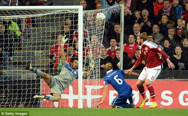 All square: Nicklas Bendtner beats Italy keeper Gianluigi Buffon to make it 1-1