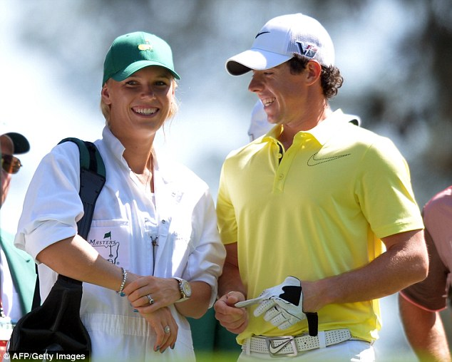 Loved up: This was Rory McIlroy and Caroline Wozniacki during the par-three competition at The Masters earlier this year - but the Northern Irishman is reported to have called time on their relationship
