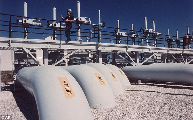 While the U.S. trails several other nations for crude oil production and stockpiles imported crude at the St James Terminal, pictured, near Baton Rouge, La., on the Mississippi River, it has ramped up production of shale