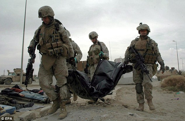 Military deaths: Two-thirds of the death toll were military related. Here US soldiers remove the body of a victim after an suicide bomber attack in Ramadi in 2006