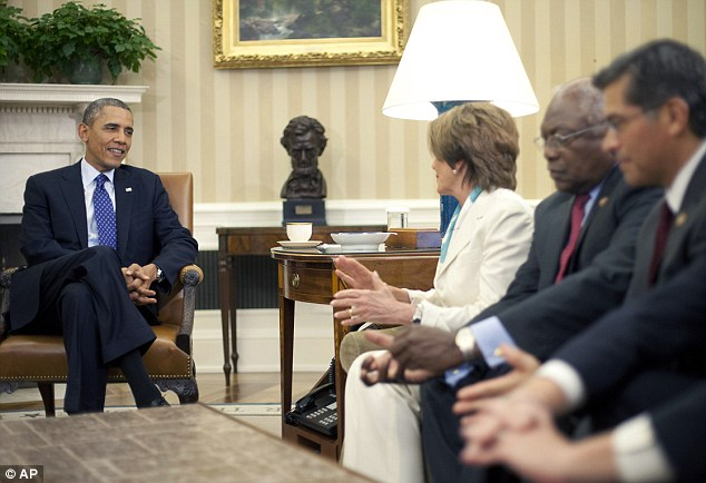 President Barack Obama talks with (from left) House Minority Leader Nancy Pelosi, Representatives James Clyburn and Xavier Becerra