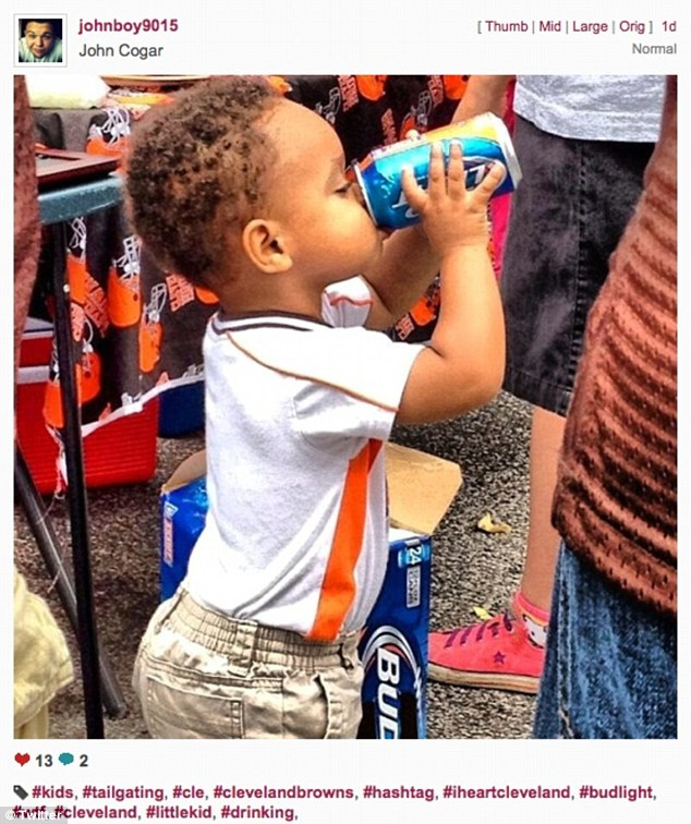 Shocking image of toddler sipping a Bud Light at Cleveland