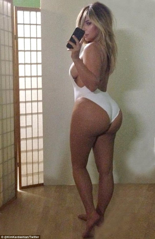 The BIG Reveal: Kim Kardashian has posted a saucy snap of herself in a white swimsuit with the caption '#NoFilter'