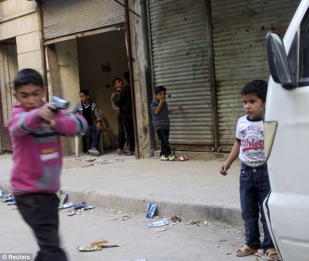 Hard life: Children play with plastic guns in Aleppo