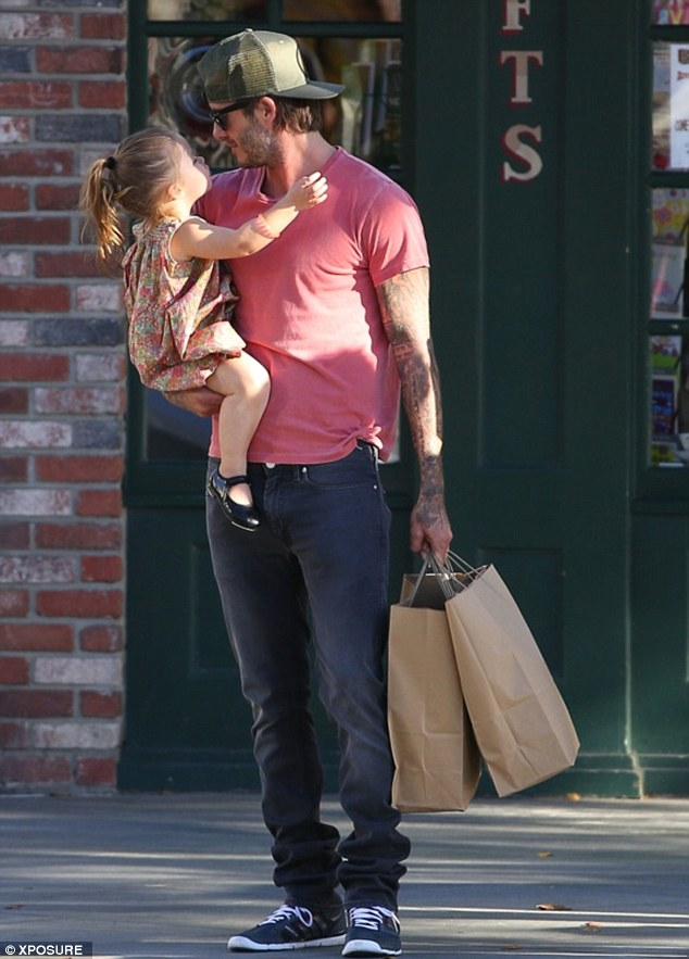 Come here daddy: Harper seemed keen to kiss her David as they left Ye Old King's Head, an English food and gift shop