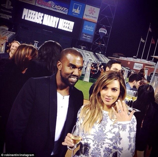 A moment to remember: Kim and Kanye celebrate their engaged status with a glass of champers