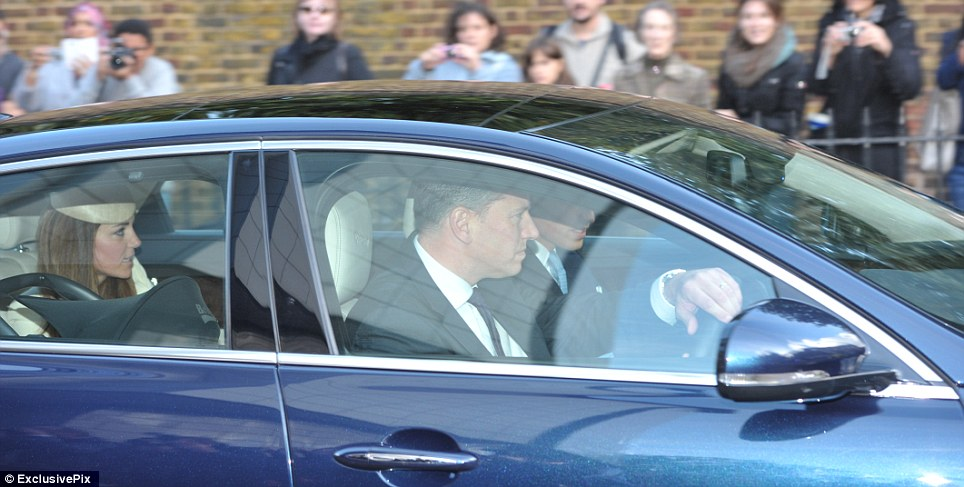 Prince George's day: The Duke and Duchess of Cambridge and future king Prince George in his car seat head off to the christening this afternoon